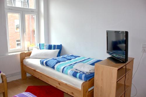 Haus Büdelsdorf - Wohnung 8 - Bett