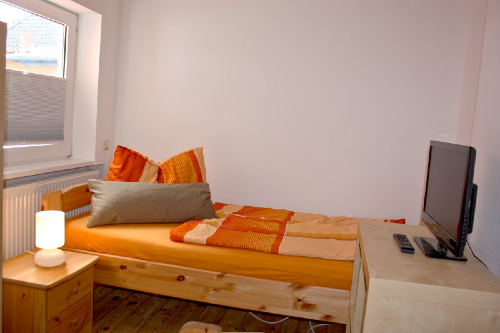 Haus Büdelsdorf - Wohnung 6 - Bett