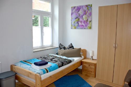 Haus Büdelsdorf - Wohnung 2 - Bett